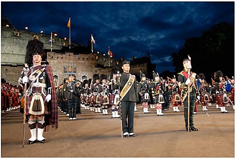 Massed Pipes and Drums against a stunning backdrop